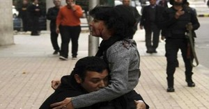 a friend desperately holding, Shaimaa Elsabbagh after she has been shot by Egyptian security