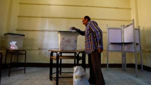 election Man-casts-his-vote-during-the-second-day-of-the-referendum-on-draft-constitutional-amendments-at-a-polling-station-in-Cairo