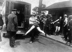Arresting women wearing one peice swimng suit 1920